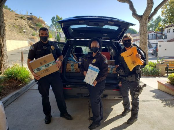 Laguna Police Play Santa with Lost Packages – NBC Los Angeles